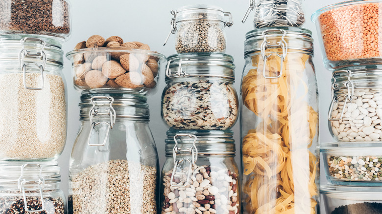 Pasta, beans, and grains in glass jars