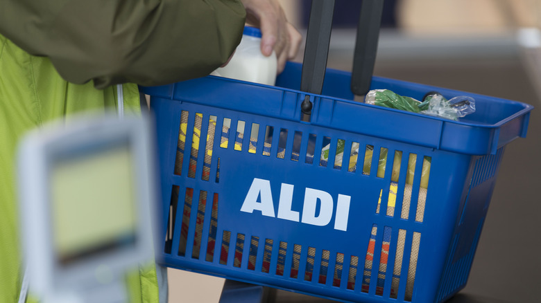 A shopper with a cart from Aldi
