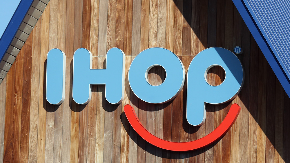 Traditional IHOP restaurant sign in blue and red