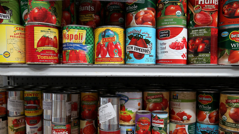 Canned tomatoes on a shelf