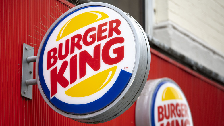 Burger King logo affixed to red wall
