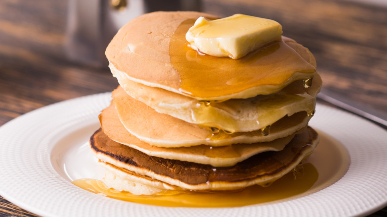 Pancakes covered with syrup and butter