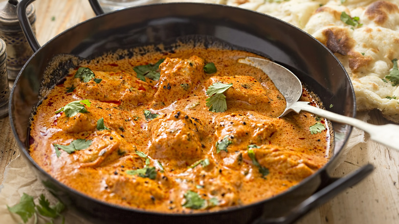 A pan with butter chicken curry