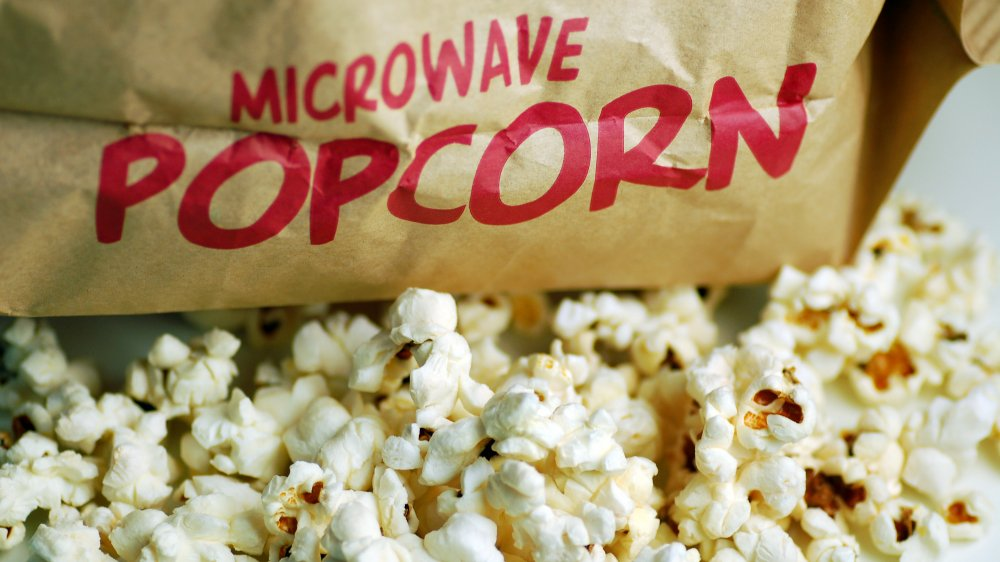 bag of microwave popcorn with popcorn spilling out