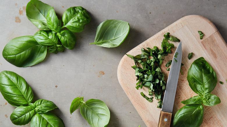 Freshly chopped basil on cutting board