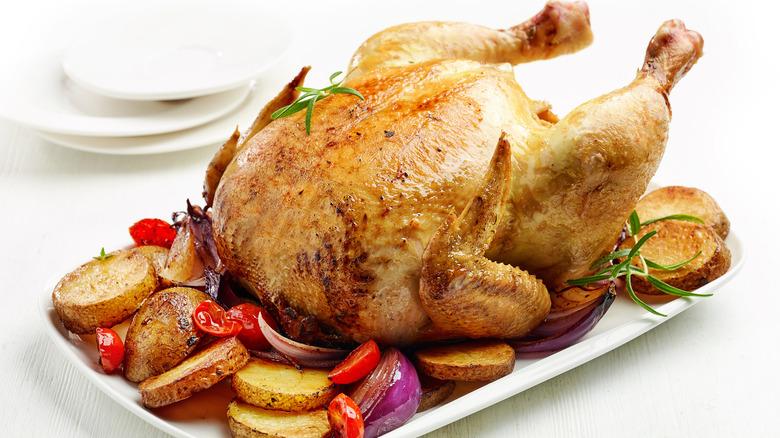 Roast chicken and vegetables on platter