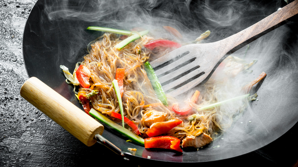 Steaming wok with food in it