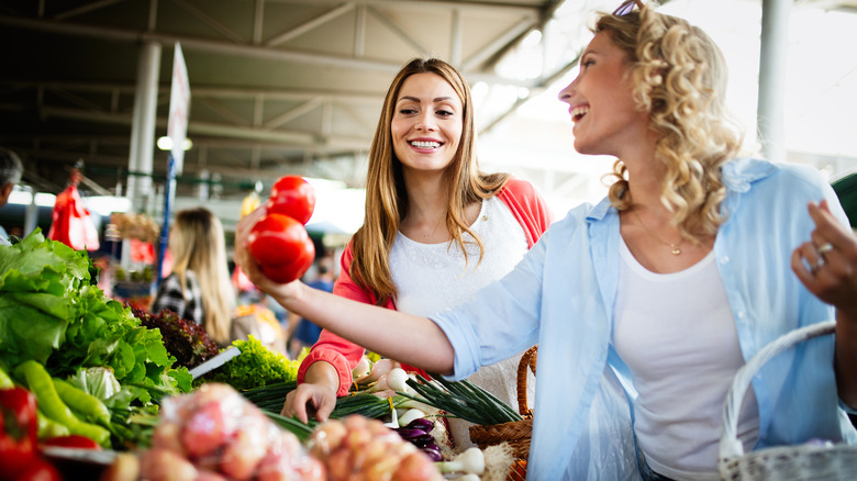 Women shopping for pre-washed produce