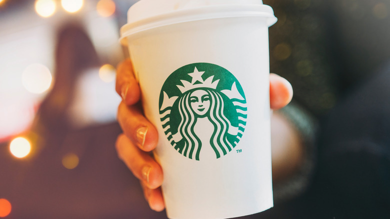 Starbucks cup with hand