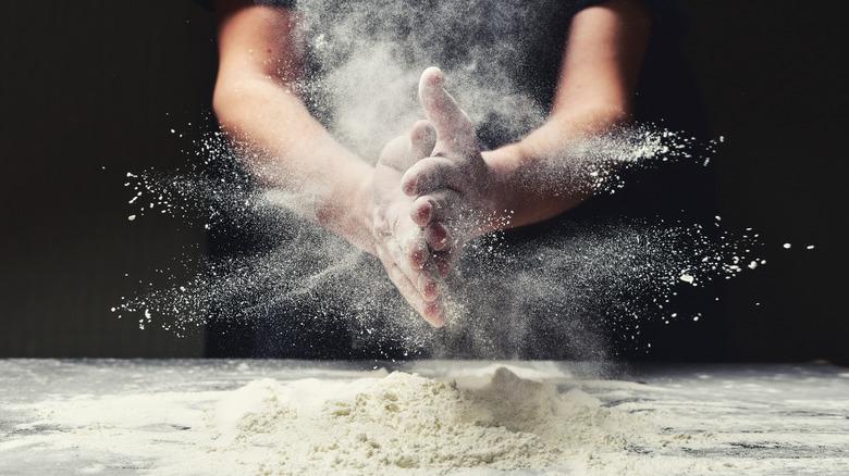 Baker's hands covered in flour