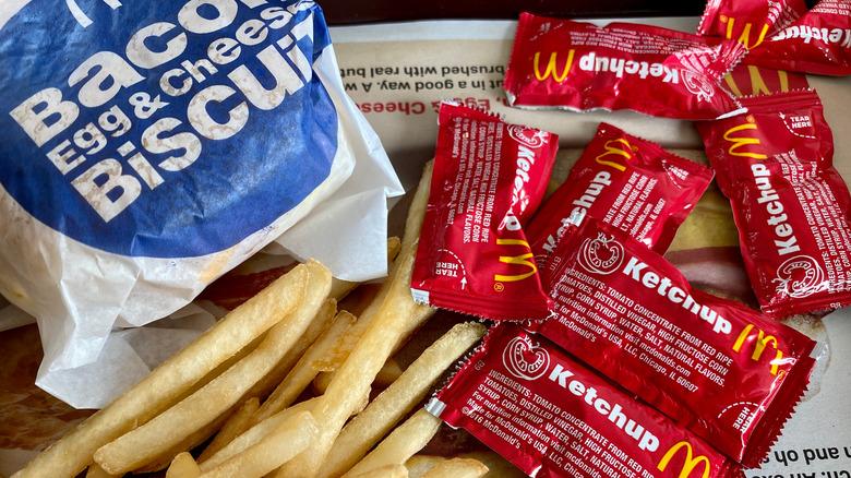 McDonald's breakfast sandwich, fries, ketchup
