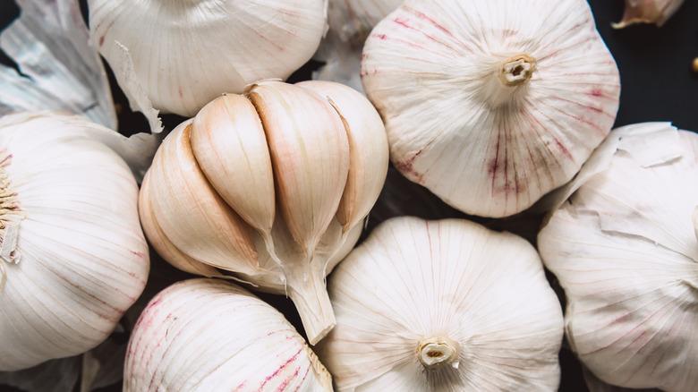 Three white garlic bulbs