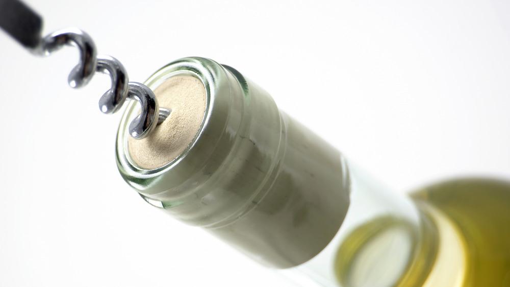 Corkscrew uncorking a bottle of wine