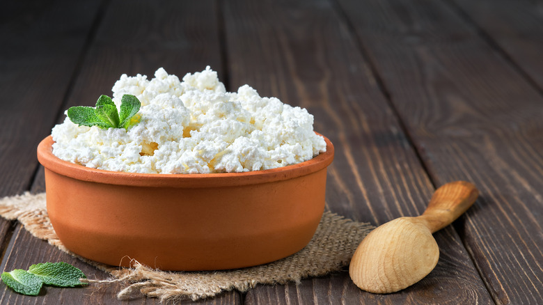Cottage cheese on wood table