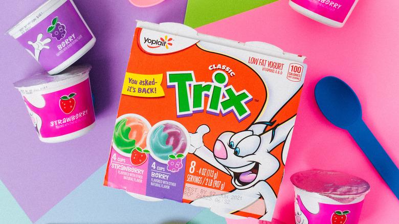 Box of Trix Yogurt next to colorful spoons