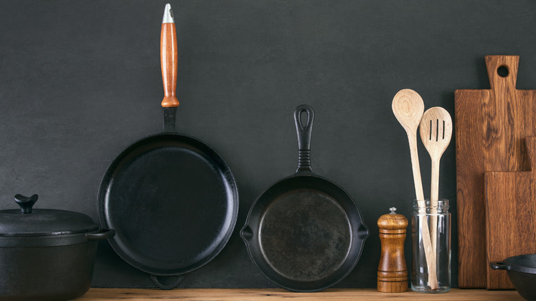 Cast iron skillets against the wall