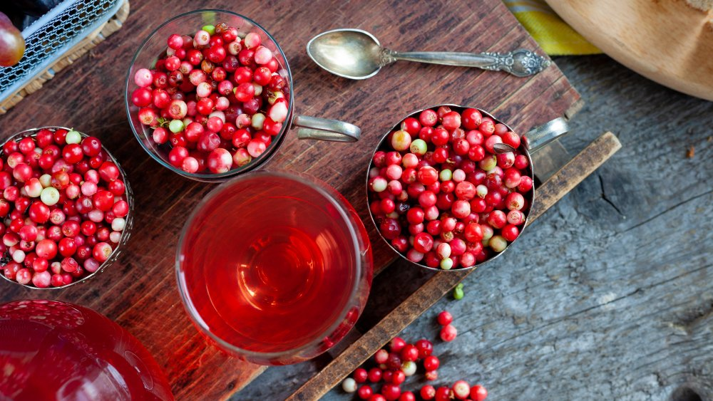 Raw lingonberries and glass of lingonberry juice
