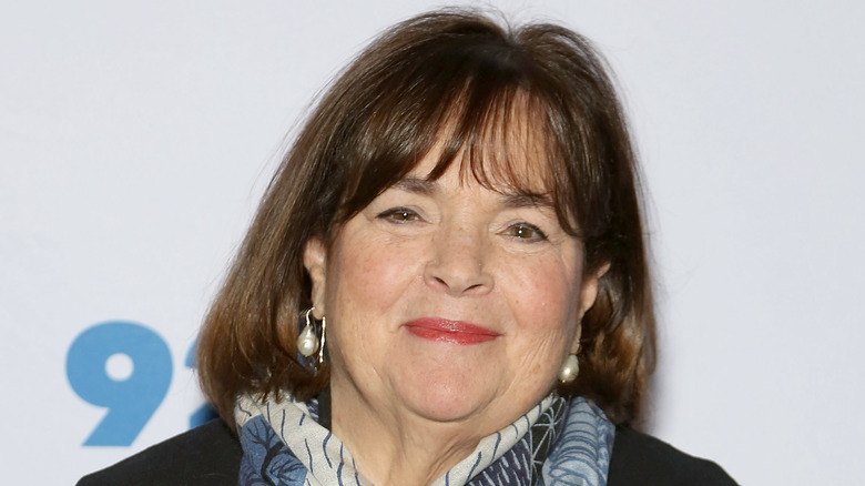 Close up of Ina Garten wearing pearl earings and a blue, black and white scarf