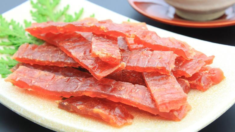 Salmon jerky strips on plate