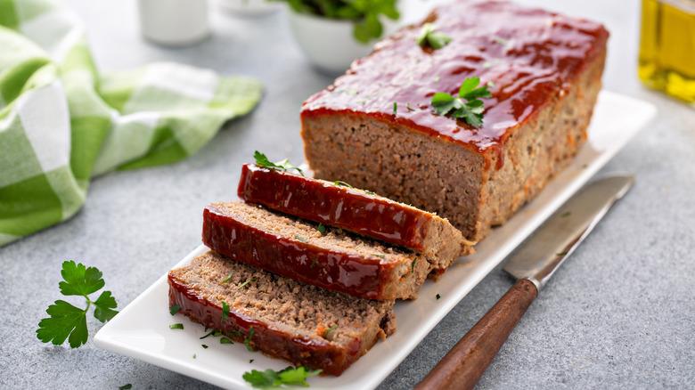 Sliced meatloaf with parsley garnish
