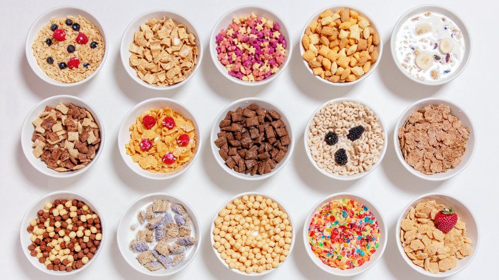 bowls with different kinds of breakfast cereals