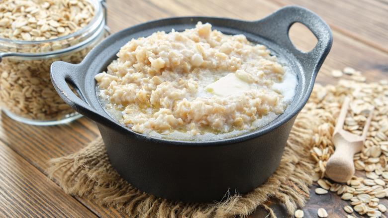 Cooked oatmeal alongside raw oats