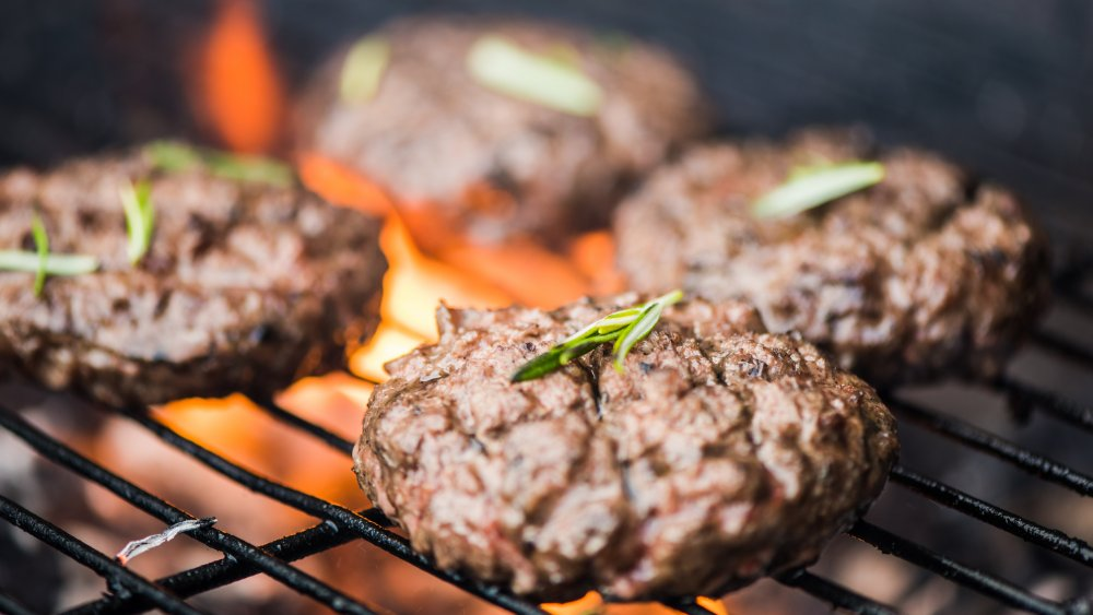 Burgers on a grill.