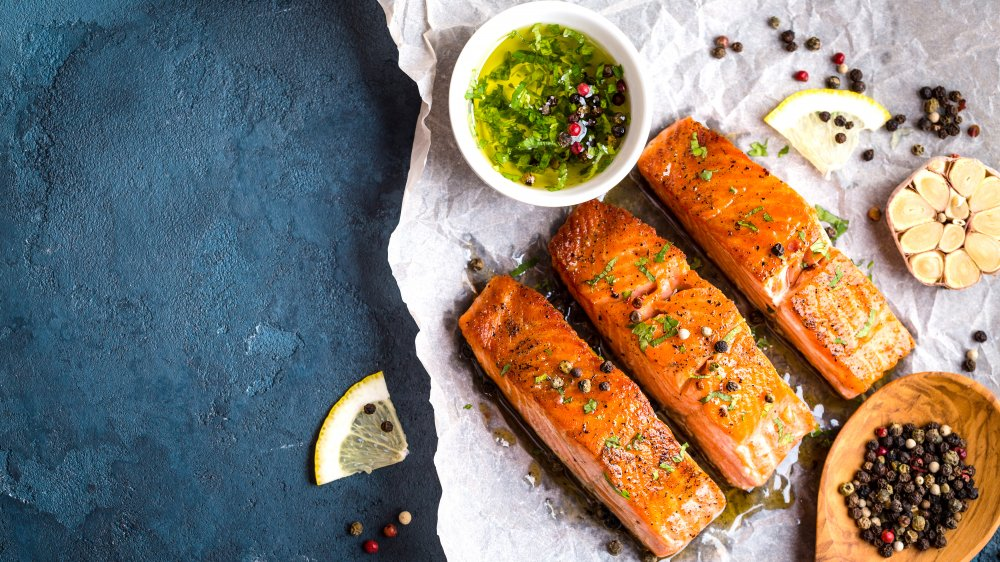 Salmon with garlic, lemon and peppercorn, salsa verde