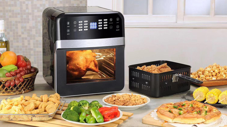 Air fryer surrounded by food