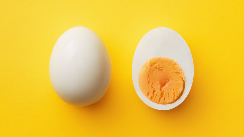 Hard-boiled egg on yellow background