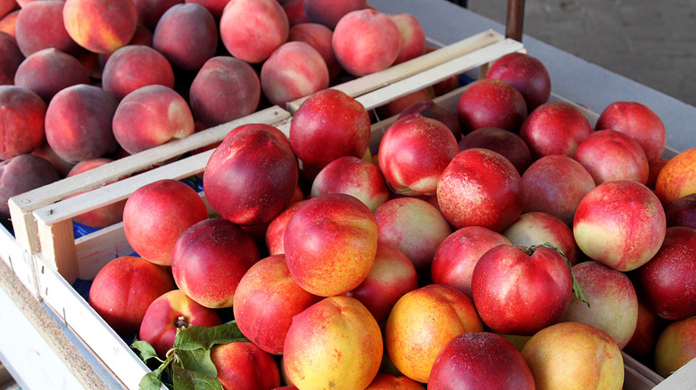 Nectarines in a wooden crate