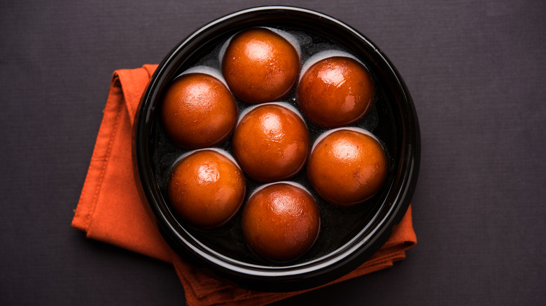 A serving of gulab jamun in a bowl