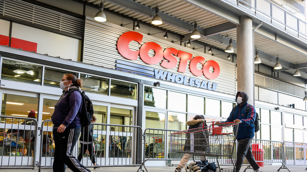 Costco storefront and customers
