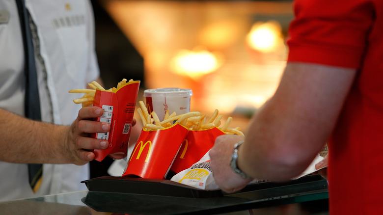 McDonald's employee placing food on tray