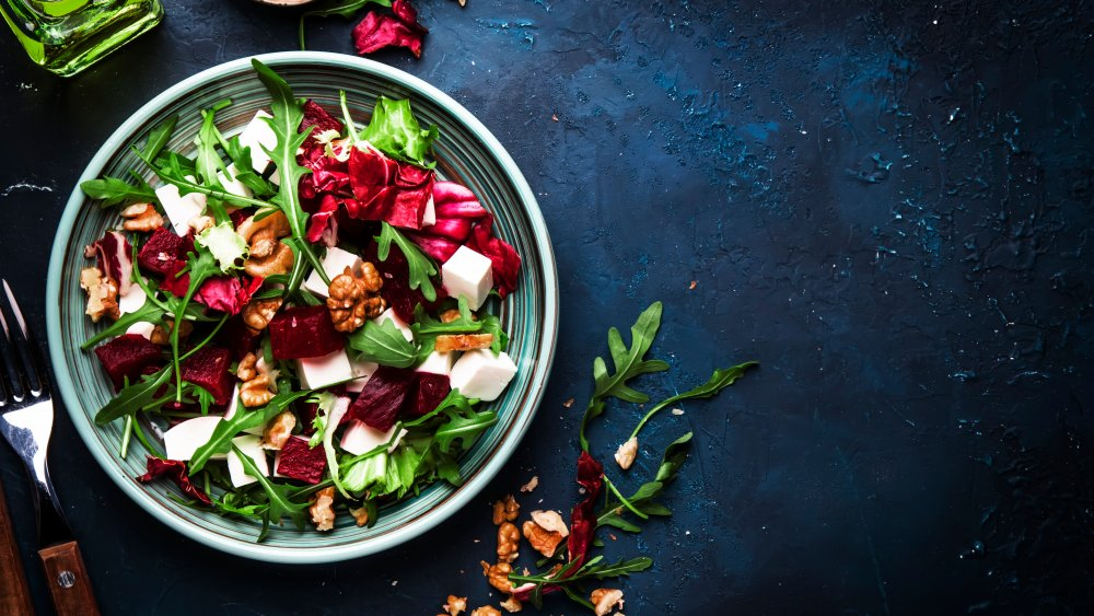 Healthy-looking salad with walnuts, beets, and cheese
