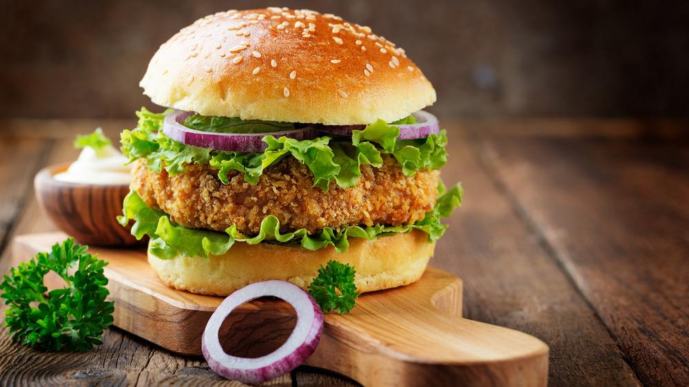 Fried chicken sandwich on cutting board