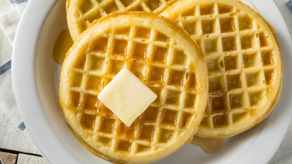 waffles on a plate with butter