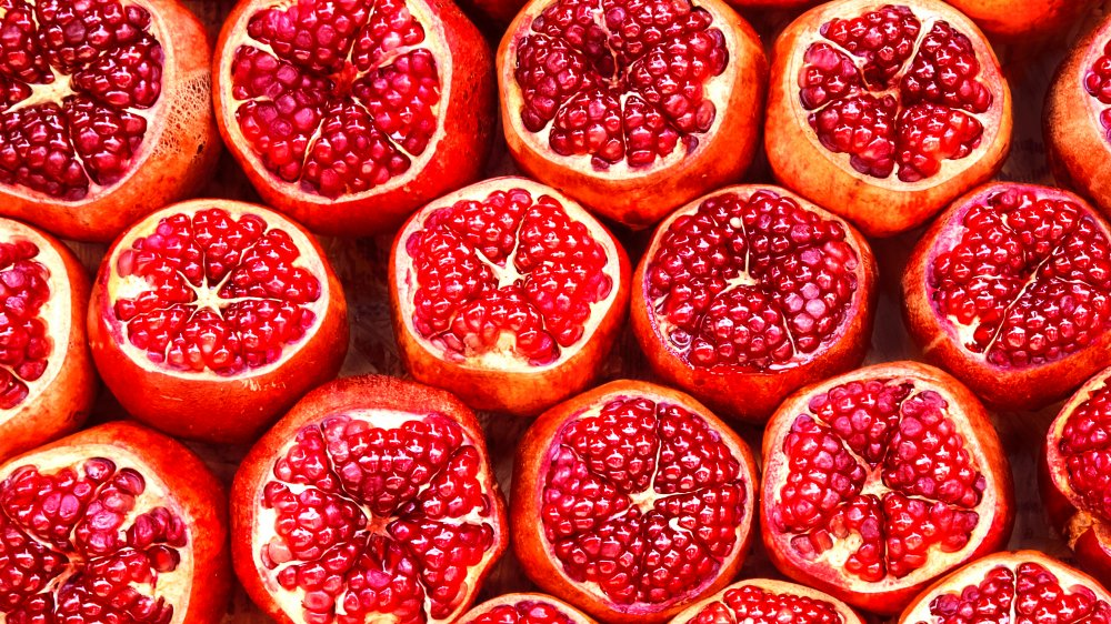 Pomegranates with tops cut off