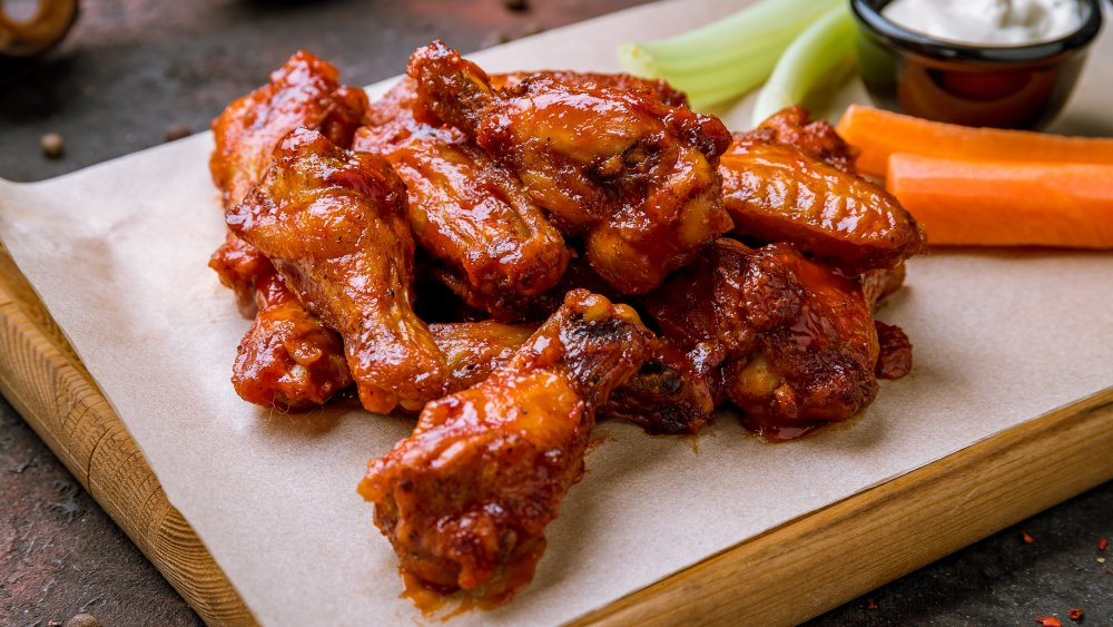chicken wings on platter with celery and carrots