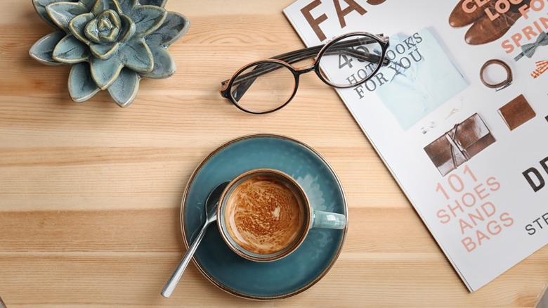 Espresso with crema, plants, office setting, modern.