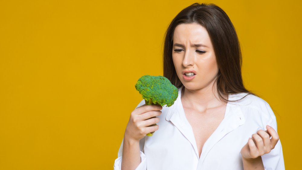 woman confused about broccoli