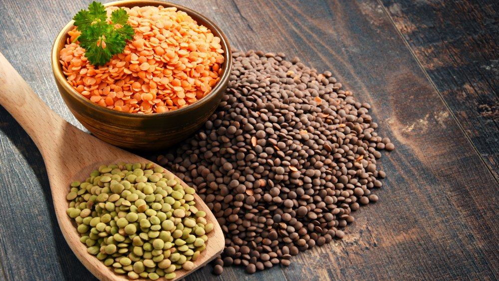 Green, red, and brown dried lentils