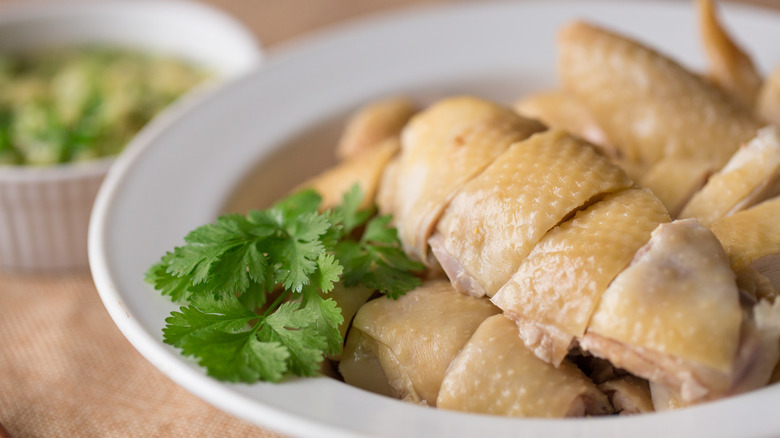 Poached chicken in bowl