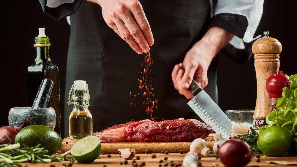 Chef seasoning steak