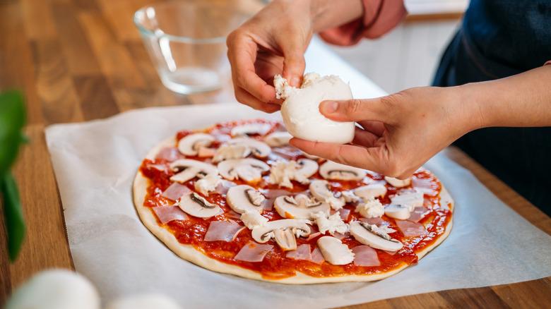 Making homemade pizza