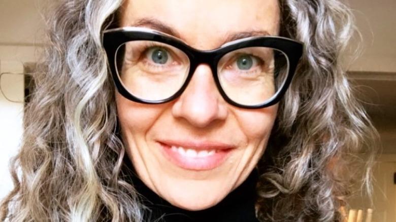 Headshot of Zoë François in black glasses